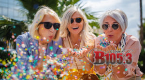 cheerful-senior-women-celebrating-by-blowing-confetti-in-the-city-picture